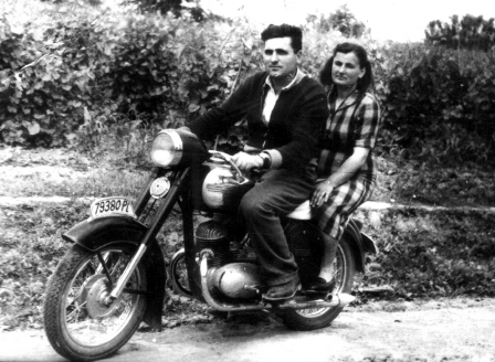 My parents sitting on the photographer's motorcycle